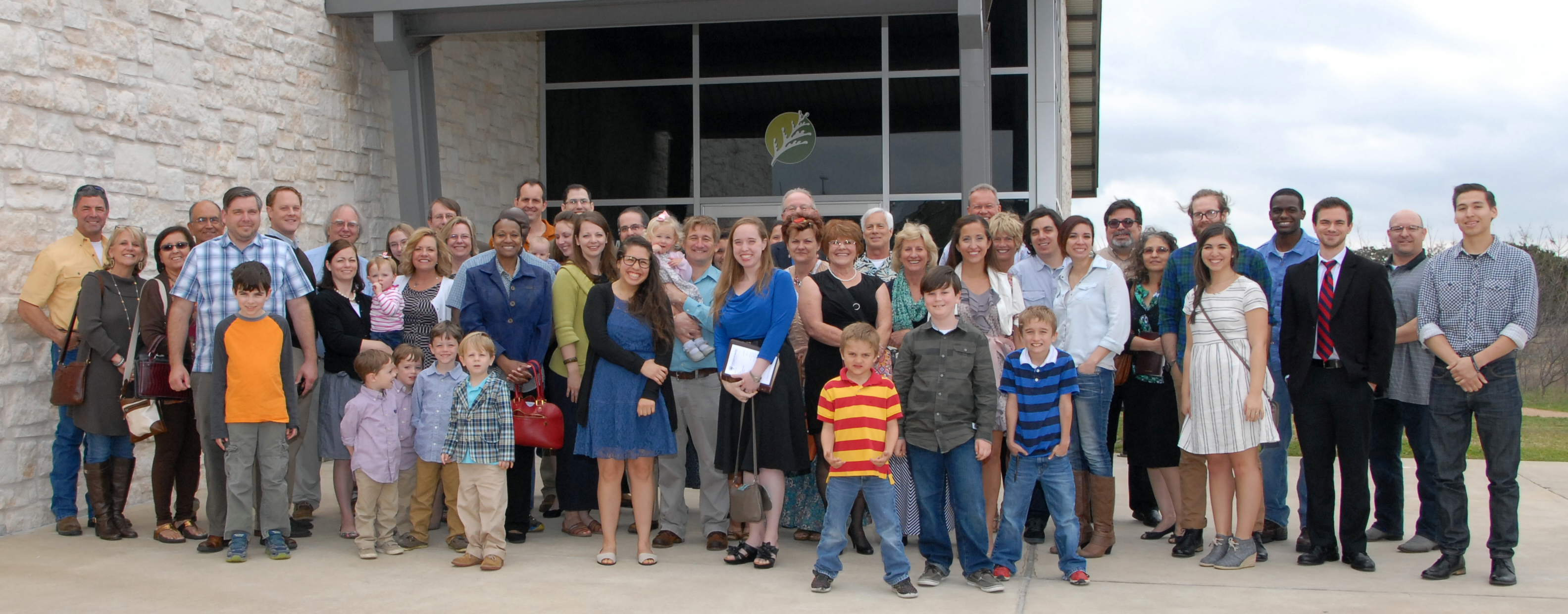 Attendees pose for a photo outside the Cedar Park Recreation Center after the first service of Cedar Pointe Baptist Church.